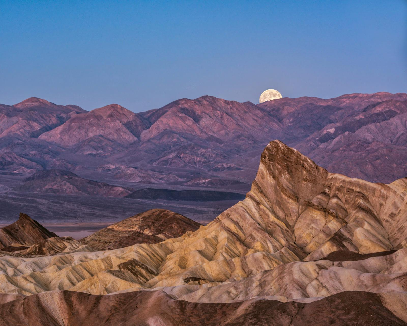 "Today's Photo Of The Day is ""Moonset Zabriskie Point"" by Rebecca Gillum. Location: Death Valley National Park, CA."
