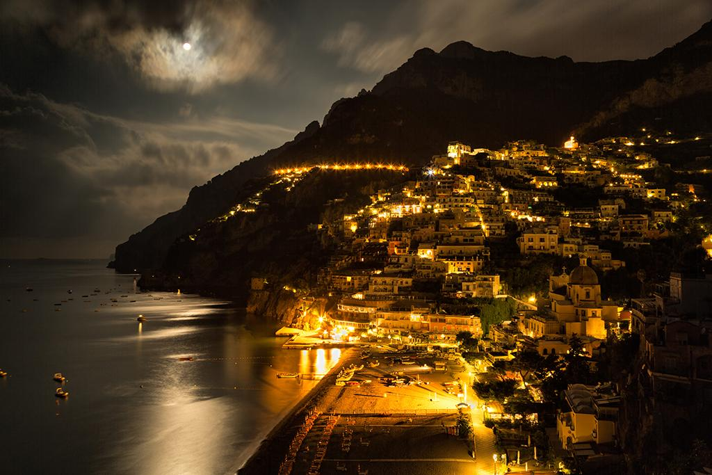 Positano, Italy. Exposing for the different light intensities – reflection, street lights, and moon – was the tricky part and required two exposures manually blended in post-processing. Canon 5D Mark III w/Canon 24-105 f/4L IS USM. Exposure: f/8, 5 seconds, ISO 200.