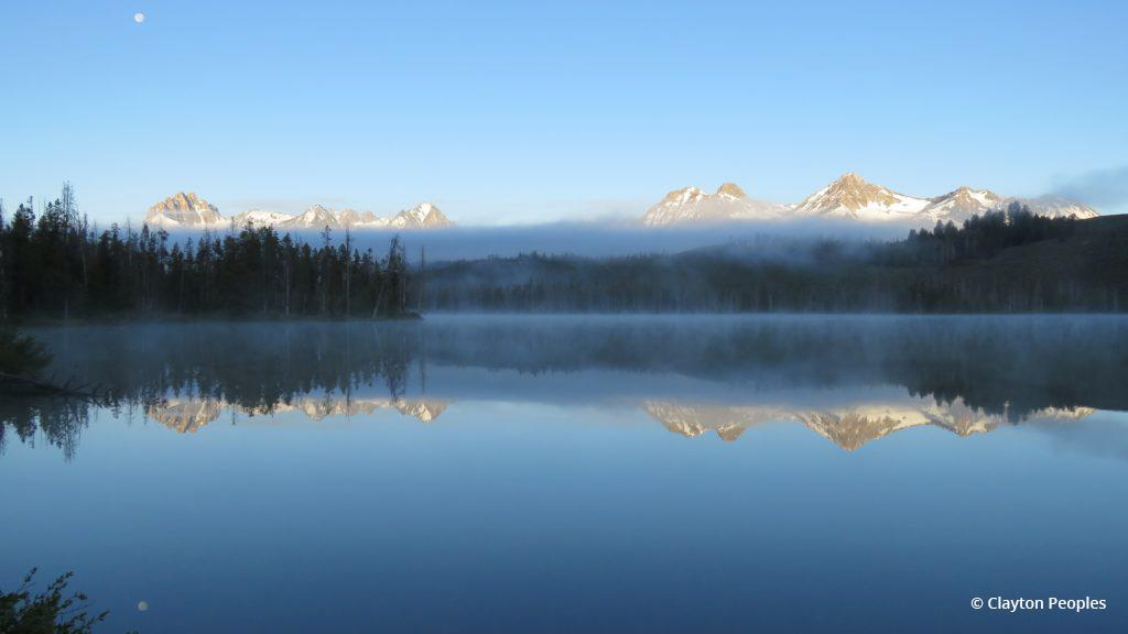 "Today's Photo Of The Day is ""Sawtooth Range Fog and Moon"" by Clayton Peoples. Location: Little Redfish Lake, Idaho."
