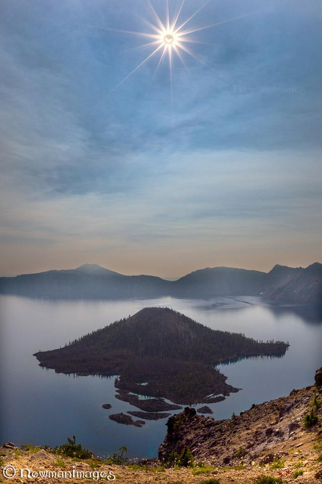 """Today's Photo Of The Day is """"Eclipse Over Wizard Island"""" by NewmanImages. Location: Crater Lake National Park, Oregon."""